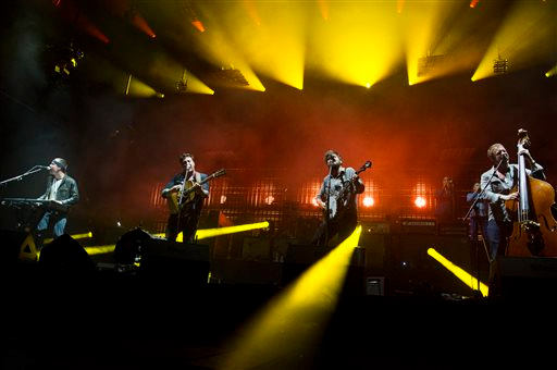 . Mumford & Sons band members, from left, Ben Lovett, Marcus Mumford, Country Winston and Ted Dwane perform on Wednesday, Aug. 28, 2013 at the West Side Tennis Club in the Forest Hills neighborhood of the Queens borough of New York. (Photo by Charles Sykes/Invision/AP)