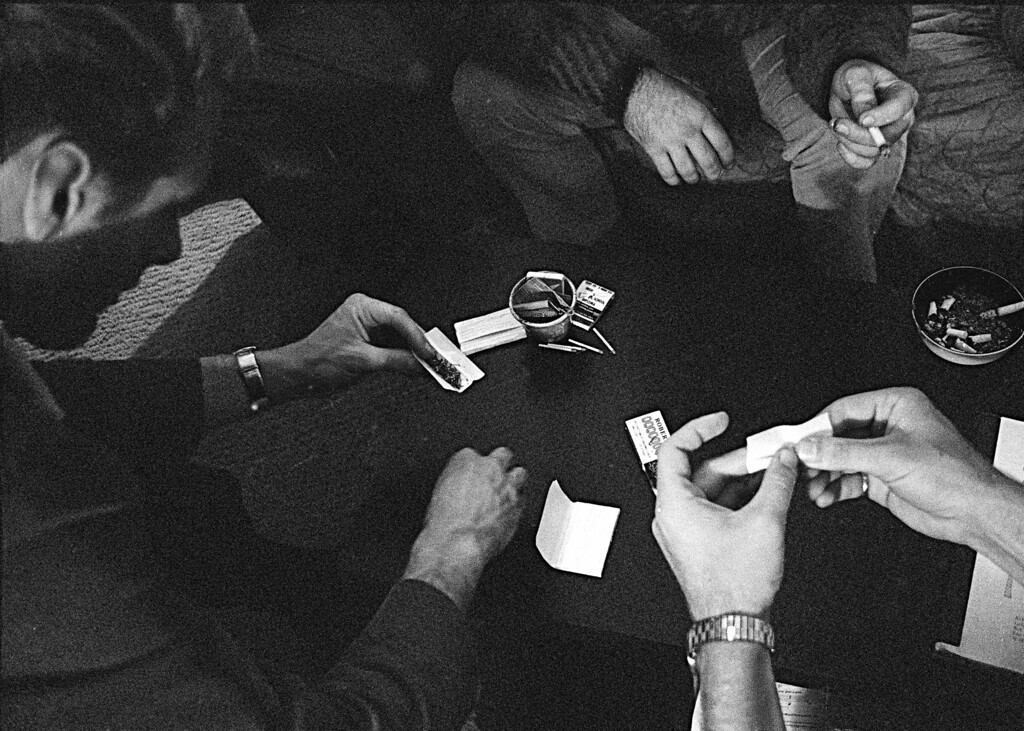 ". FILE - In this May 23, 1966, file photo, people roll joints at a marijuana party near the University of California at Berkeley campus in Berkeley, Calif. In 2012, Washington state and Colorado voted to legalize and regulate its recreational use. But before that, the plant, renowned since ancient times for its strong fibers, medical use and mind-altering properties, was a staple crop of the colonies, an ""assassin of youth,\"" a counterculture emblem and a widely accepted - if often abused - medicine. On the occasion of  �Legalization Day,� Thursday, Dec. 6, 2012, when Washington�s new law takes effect, AP takes a look back at the cultural and legal status of the �evil weed� in American history. (AP Photo/File)"
