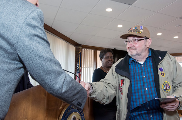 10/29/18 Wesley Bunnell | Staff Congressman John Larson (CT-01) presented 14 Vietnam Veterans with Vietnam Veteran lapel pin's during a ceremony at Berlin Town Hall in commemoration of the 50th anniversary of the Vietnam War. Berlin Mayor Mark Kaczynski shakes hands with Vietnam Vet Richard Kotek.