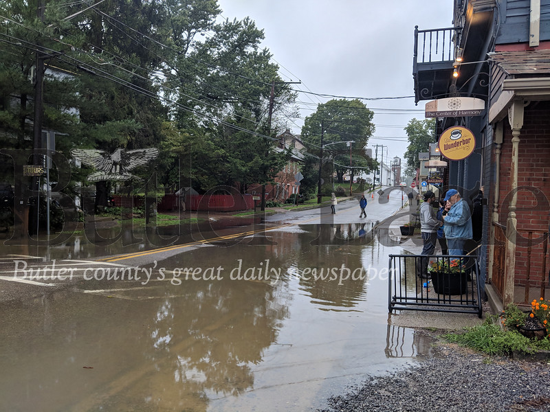 Mercer Street in Harmony, where many of the borough businesses are located, was closed to traffic due to Sunday's storms. Residents blamed poor drainage in the borough and the overflowing Connoquennessing Creek. (photos by Caleb Harshberger)