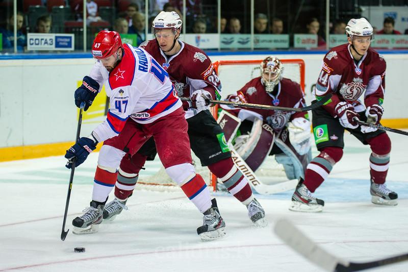 Andris Dzerins (25) of Dinamo Riga tries to stop Radulov Alexander (47)