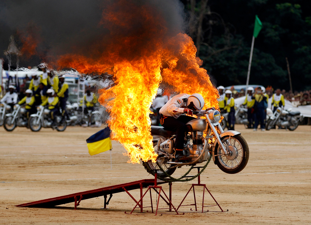 . An Indian army officer drives through a burning ring during a function to mark India\'s Independence Day in Bangalore, India, Thursday, Aug. 15, 2013. (AP Photo/Aijaz Rahi)