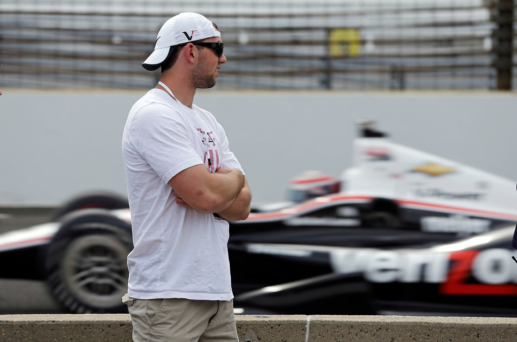 . Indianapolis Colts quarterback Andrew Luck watches cars on the track during practice for the Indianapolis 500 auto race, at Indianapolis Motor Speedway in Indianapolis, Wednesday, May 15, 2013. (AP Photo/Darron Cummings)