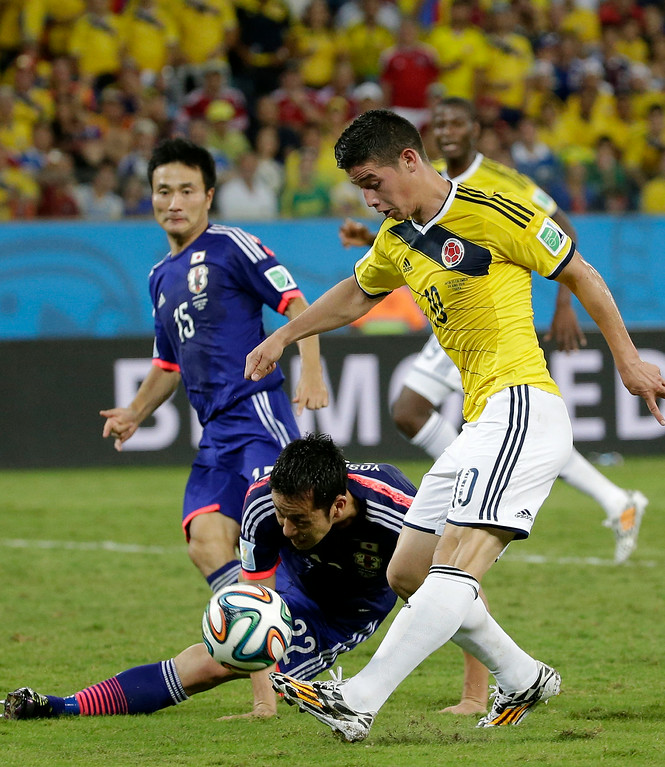 . Colombia\'s James Rodriguez scores his teams fourth goal during the group C World Cup soccer match between Japan and Colombia at the Arena Pantanal in Cuiaba, Brazil, Tuesday, June 24, 2014. (AP Photo/Felipe Dana)
