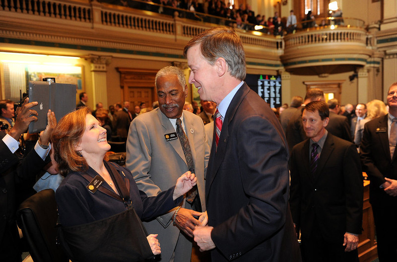". Governor John Hickenlooper speaks with state senator Linda Newell, left and state representative John Buckner after his speech. John Hickenlooper gave his third State of the State address before a packed audience in the House Chambers of the State Capitol on January 10th, 2013.  The Governor took on the issue of gun regulations in his State of the State speech  calling for universal background checks for all gun purchases. In his third such address to the legislature, Hickenlooper, a Democrat, also called for a moment of silence in the House chamber to remember the victims of the Aurora shooting massacre and said Coloradans ""have an obligation to prevent similar tragedies.\"" The mayor, police chief and fire chief of Aurora were present for the governor\'s annual address.  -  Helen H. Richardson, The Denver Post"