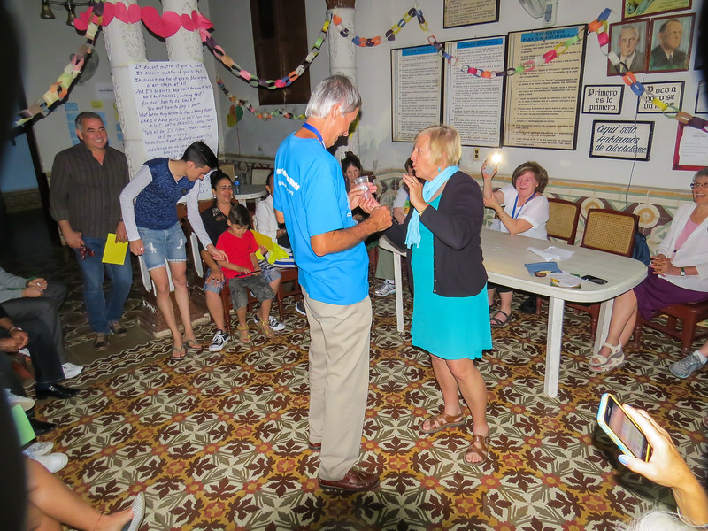 Diane awards our fantastic Leader Jeff Rogo with mementos of our weeks together. Pat appears to be holding Tinkerbell in her hand.