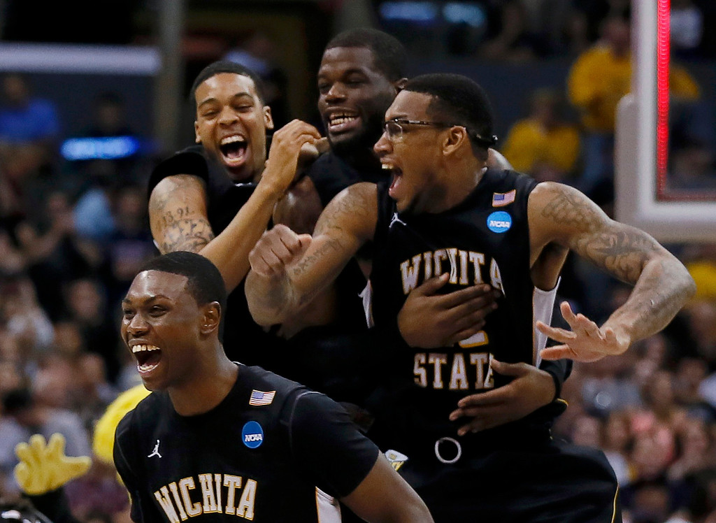 . Wichita State Shockers\' Carl Hall, Chadrack Lufile, Demetric Williams and Cleanthony Early (R to L) celebrate defeating the Ohio State Buckeyes in their West Regional NCAA men\'s basketball game in Los Angeles, California March 30, 2013. REUTERS/Lucy Nicholson