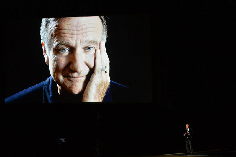 . Actor Billy Crystal (R) speaks in tribute to the late Robin Williams onstage at the 66th Annual Primetime Emmy Awards held at Nokia Theatre L.A. Live on August 25, 2014 in Los Angeles, California.  (Photo by Kevin Winter/Getty Images)