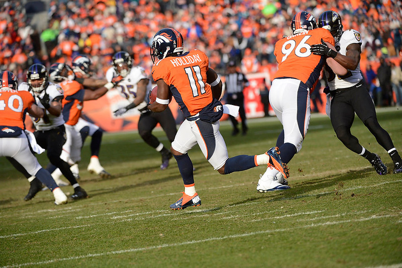 . Denver Broncos wide receiver Trindon Holliday (11) returns a punt in the first quarter. The Denver Broncos vs Baltimore Ravens AFC Divisional playoff game at Sports Authority Field Saturday January 12, 2013. (Photo by Joe Amon,/The Denver Post)