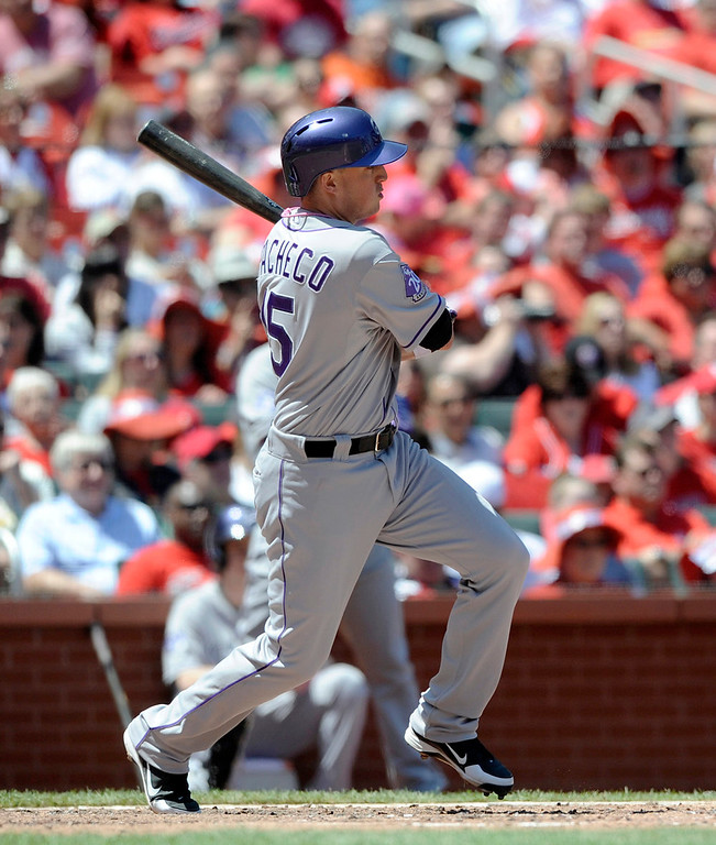. Colorado Rockies\' Jordan Pacheco (5) watches his single against the St. Louis Cardinals in the third inning in a baseball game Sunday, May 12, 2013, at Busch Stadium in St. Louis. (AP Photo/Bill Boyce)