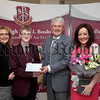 Year 9 student St Pauls HS Bessbrook Niall Campbell who achieved  second place in Northern Ireland GCSE Irish,pictured with his mum Grainne,Chairman of Board of Governors  Mr John Campbell who presented tokens to Niall and teacher/ Head of Irish Miss Ciara Mc Coy.R1406706