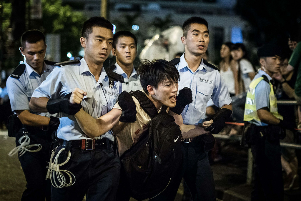 . Policemen remove protesters in the central district after a pro-democracy rally seeking greater democracy in Hong Kong early on July 2, 2014 as frustration grows over the influence of Beijing on the city.  Scores of protesters were forcibly removed by police in the early hours following a massive pro-democracy rally which organisers said saw a turnout of over half a million.    PHILIPPE LOPEZ/AFP/Getty Images