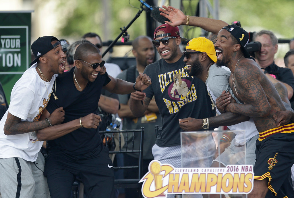 . Cleveland Cavaliers\' Jordan McRae, left to right, James Jones, Dahntay Jones, LeBron James, and J.R. Smith all share a laugh during a rally, Wednesday, June 22, 2016, in Cleveland. The Cavaliers made history by overcoming a 3-1 deficit to beat the Golden State Warriors in the NBA Finals and end the city\'s 52-year drought without a professional sports championship. (AP Photo/Tony Dejak)