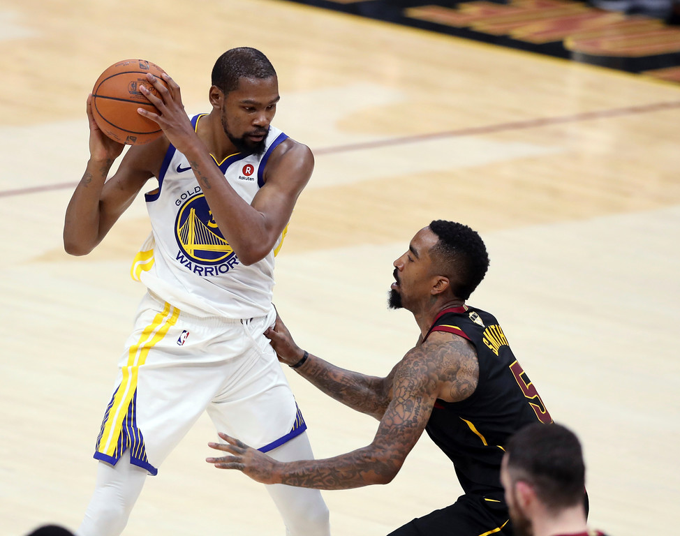 . Golden State Warriors\' Kevin Durant is defended by Cleveland Cavaliers\' JR Smith during the second half of Game 4 of basketball\'s NBA Finals, Friday, June 8, 2018, in Cleveland. (AP Photo/Carlos Osorio)