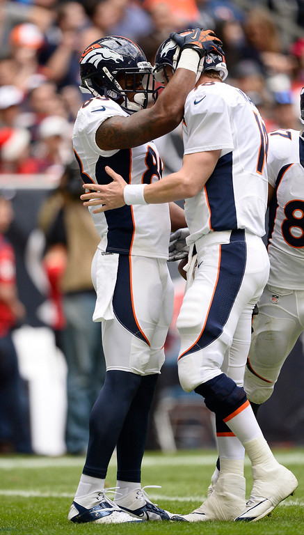 . Denver Broncos quarterback Peyton Manning (18) congratulates Denver Broncos wide receiver Demaryius Thomas (88) after his touchdown catch during the second quarter December 22, 2013 at Reliant Stadium. (Photo by John Leyba/The Denver Post)