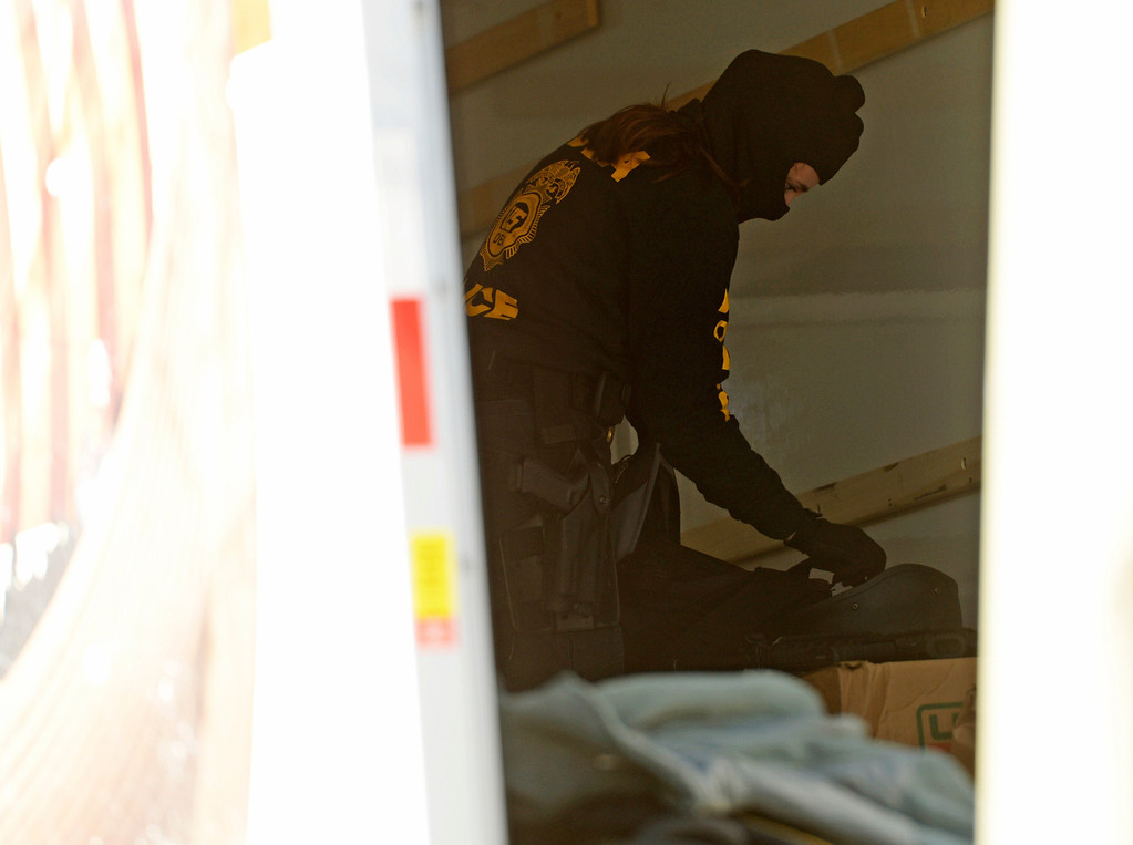 . Drug Enforcement Agency agent loads items into a U-Haul moving during a raid at VIP Cannabis, located at 2949 W. Alameda Ave., April 30, 2014. The marijuana dispensary was previously raided in November 2013. (Photo by RJ Sangosti/The Denver Post)