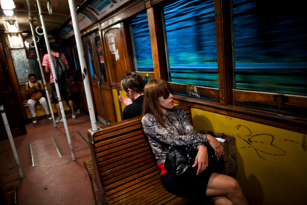Description of . Passengers travel in a wooden carriage car on the historic subway system, Line A, in Buenos Aires, Argentina, Wednesday, Jan. 2, 2013. The city government announced that the almost 100-year-old 'La Brugeoise' wooden carriages will be replaced in a short time by modern Chinese units. (AP Photo/Natacha Pisarenko)
