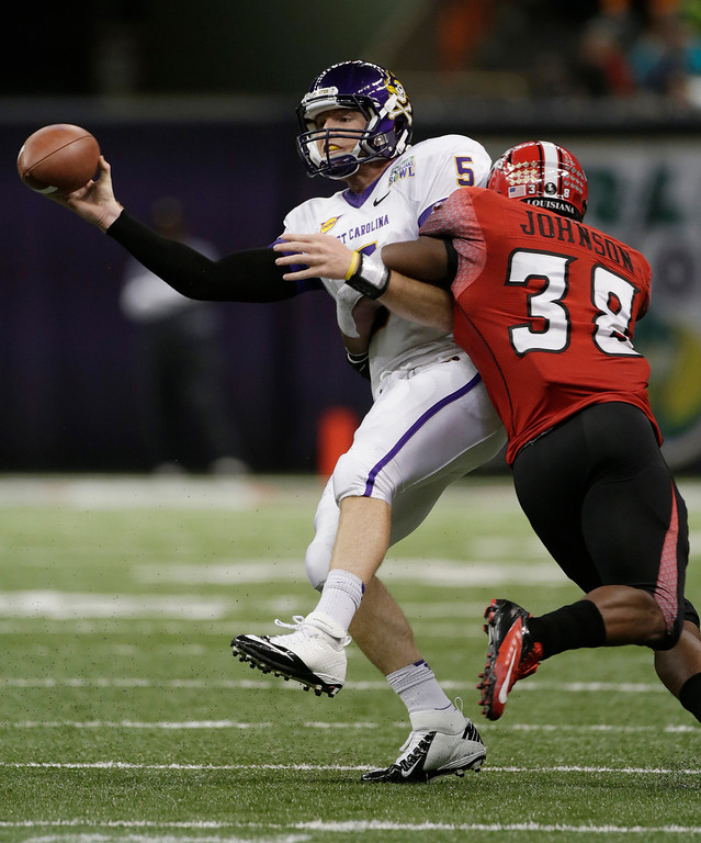 . East Carolina quarterback Shane Carden (5) is sacked by Louisiana-Lafayette linebacker Trae Johnson (38) in second half of the New Orleans Bowl, an NCAA college football game in New Orleans, Saturday, Dec. 22, 2012. Louisiana-Lafayette beat East Carolina 43-34.(AP Photo/Dave Martin)