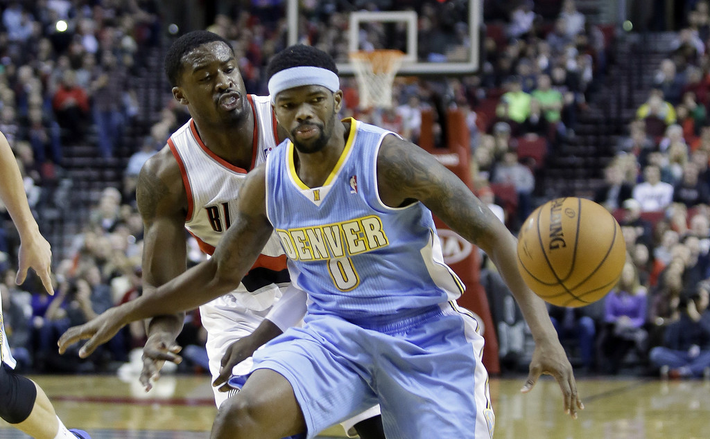 . Portland Trail Blazers guard Wesley Matthews, left, knocks the ball out of the hands of Denver Nuggets guard Aaron Brooks during the first half of an NBA basketball game in Portland, Ore., Saturday, March 1, 2014. (AP Photo/Don Ryan)