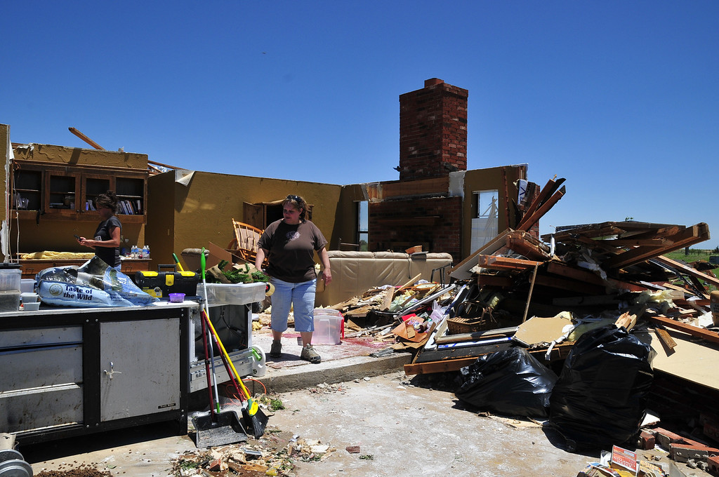 . Tammy Wade looks over what is left of her home that was destroyed by Friday\'s tornado that ripped through El Reno Okla. Saturday June 1, 2013 in El Reno Okla.  (AP Photo/Nick Oxford)