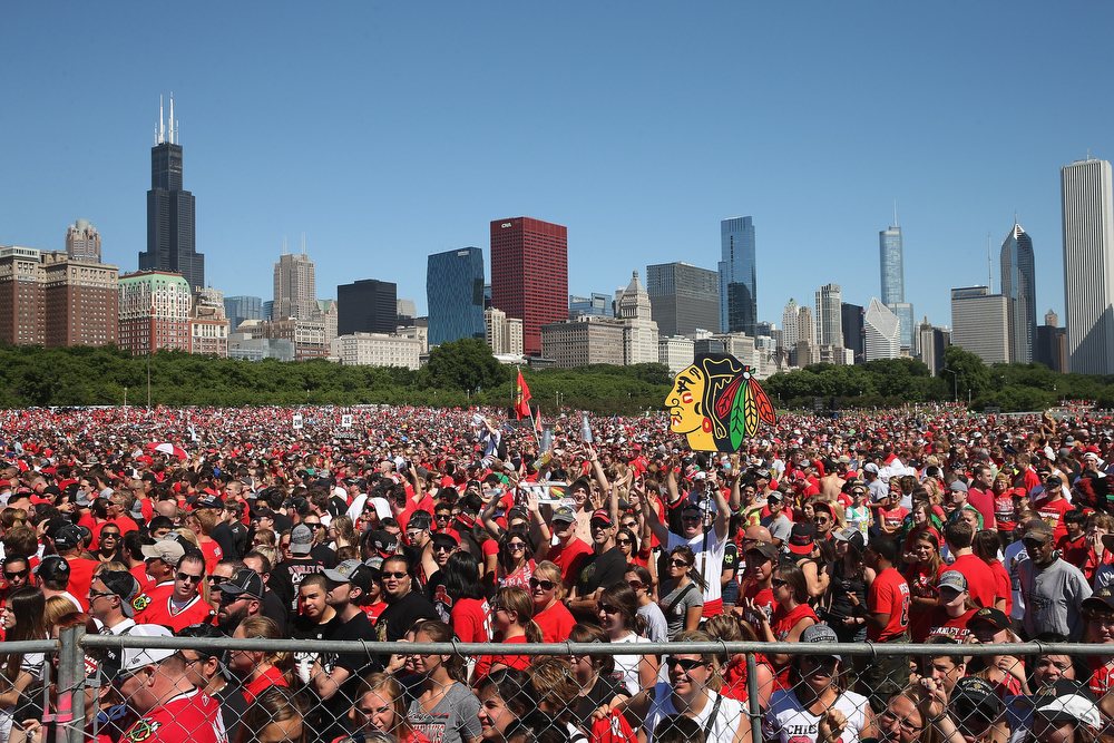 . Fans gather for a rally for the Chicago Blackhawks in Grant Park on June 28, 2013 in Chicago, Illinois. The Blackhawks defeated the Boston Bruins in 6 games to win the National Hockey League\'s Stanley Cup for the second time in four seasons.  (Photo by Scott Olson/Getty Images)