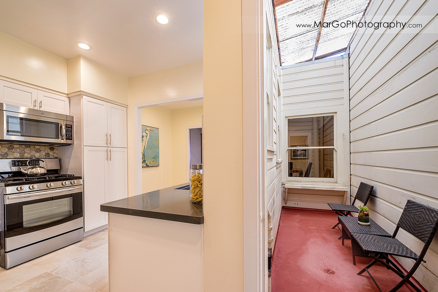 San Francisco house kitchen with white cabinets and inner patio / balcony - real estate photography