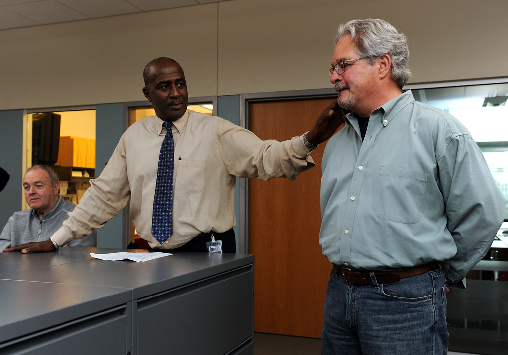 ". William Dean Singleton, Chairman & Publisher, left, and Gregory L. Moore, Editor, center, congratulate Mike Keefe in the newsroom. Denver Post editorial cartoonist Mike Keefe has won the 2011 Pulitzer Prize for a distinguished cartoon or portfolio of cartoons. Keefe\'s entry was a portfolio of 20 editorial cartoons. The judges cited him for his range of his work and a cartooning style that employs a ""loose, expressive style to send strong, witty messages.\"" Kathryn Scott Osler, The Denver Post"