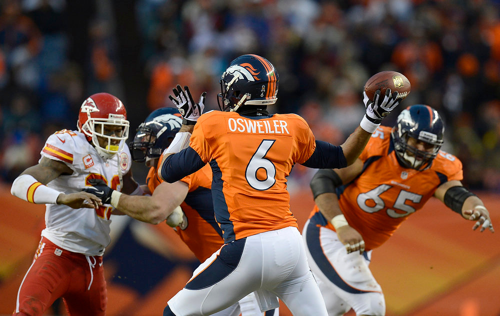 . Denver Broncos quarterback Brock Osweiler (6) drops back to pass during the fourth quarter. The Denver Broncos vs Kansas City Chiefs at Sports Authority Field Sunday December 30, 2012. Joe Amon, The Denver Post