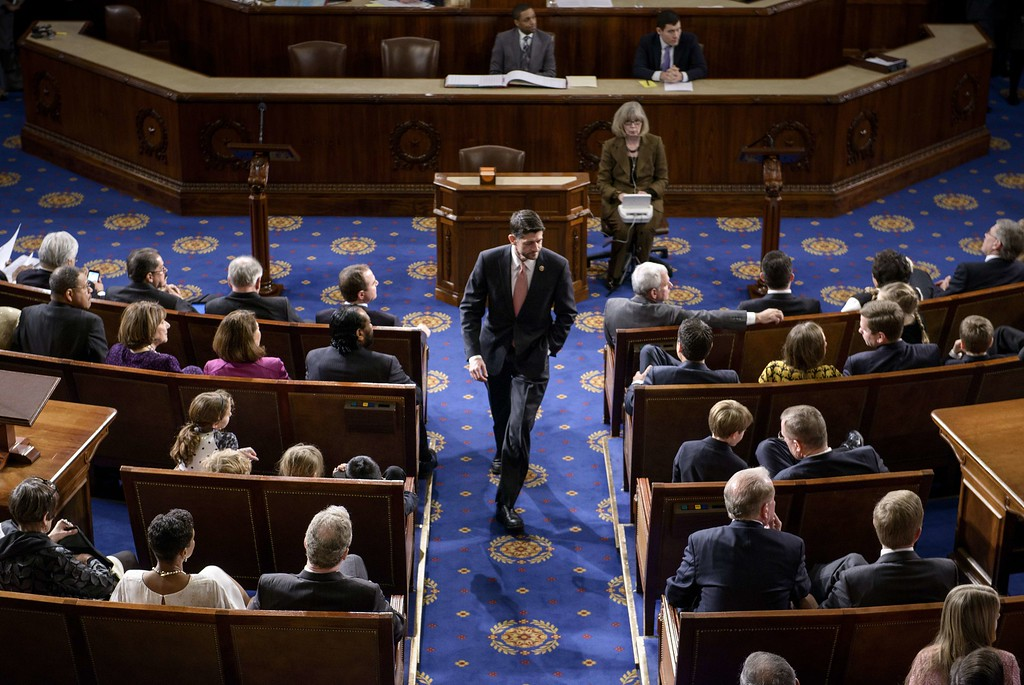 . Rep. Paul Ryan (R-WI) walks on the House floor on Capitol Hill January 6, 2015 in Washington, DC. The 114th Congress convened today with Republicans taking majority control of both the Senate and House of Representatives. BRENDAN SMIALOWSKI/AFP/Getty Images