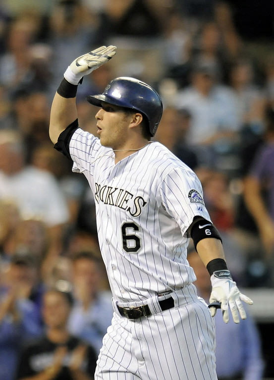 . Colorado Rockies Corey Dickerson celebrates after hitting a solo home run in the fifth inning of a baseball game against the Washington Nationals on Tuesday, July 22, 2014, in Denver. (AP Photo/Chris Schneider)