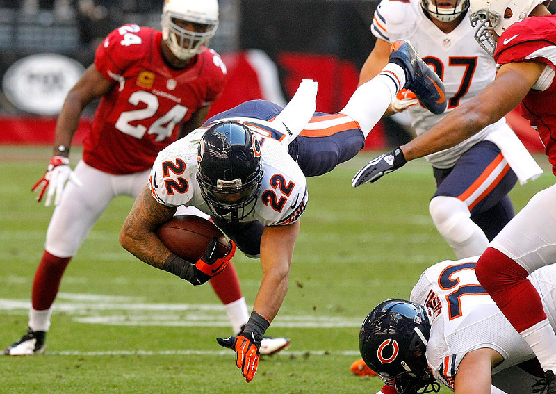 . Chicago Bears running back Matt Forte (22) is tripped up against the Arizona Cardinals during the first half of an NFL football game, Sunday, Dec. 23, 2012, in Glendale, Ariz. (AP Photo/Rick Scuteri)