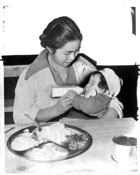 """""""Good Food and plenty of it is served to the Japanese evacuees at the Santa Anita reception center"""" -- caption on photograph"""