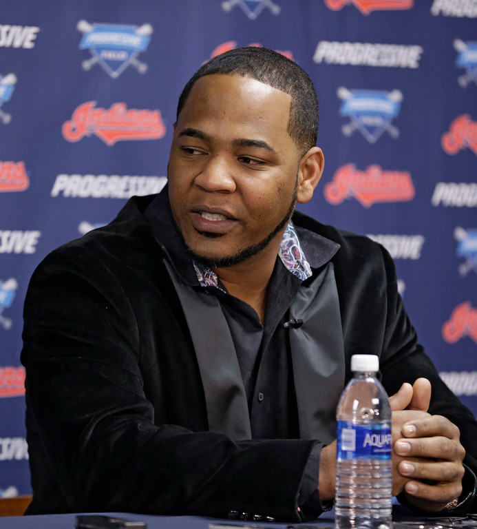 . Cleveland Indians\' Edwin Encarnacion answers questions during a news conference, Thursday, Jan. 5, 2017, in Cleveland. One win from a baseball World Series title last season, the Indians finalized a $65 million, three-year contract with free agent slugger Encarnacion. (AP Photo/Tony Dejak)