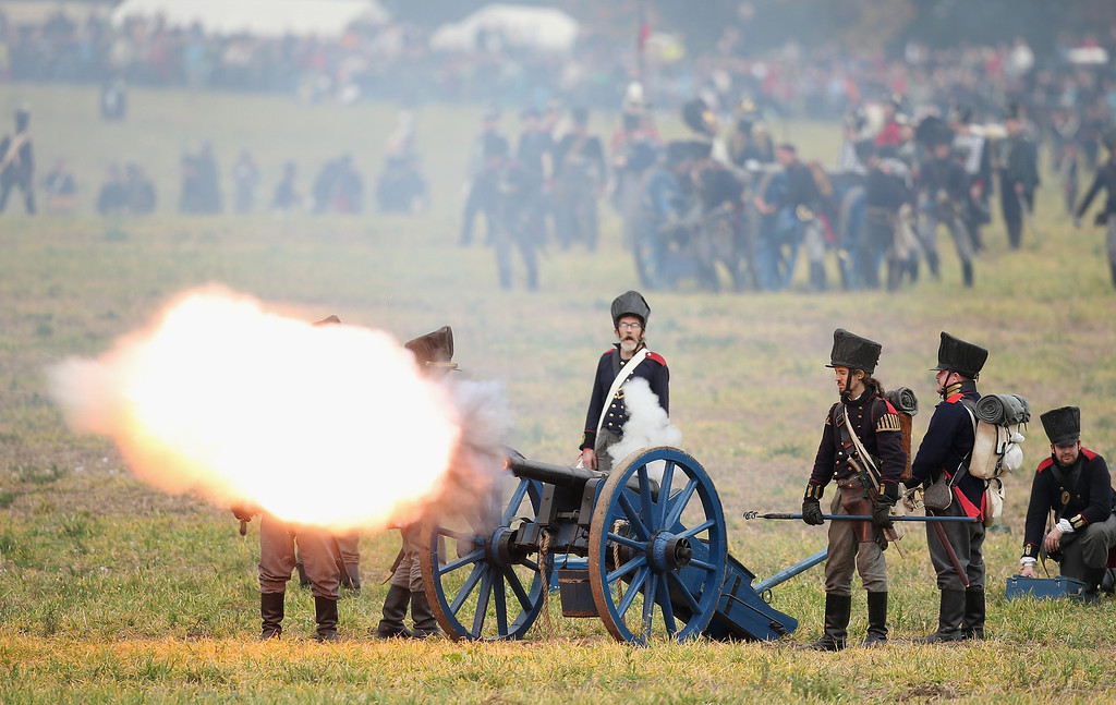 . Historical society enthusiasts in the role of Prussian artillery soldiers fire against troops loyal to Napoleon during the re-enactment of The Battle of Nations on its 200th anniversary on October 20, 2013 near Leipzig, Germany.   (Photo by Sean Gallup/Getty Images)