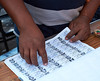 Election day in Santa Ana: <br /> Checking the register for a voter's information.