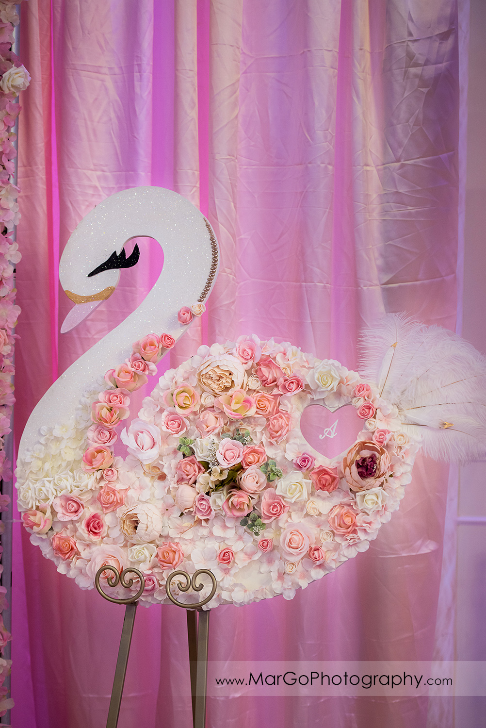 swan decorated with white and pink roses at Newark Oasis Palace