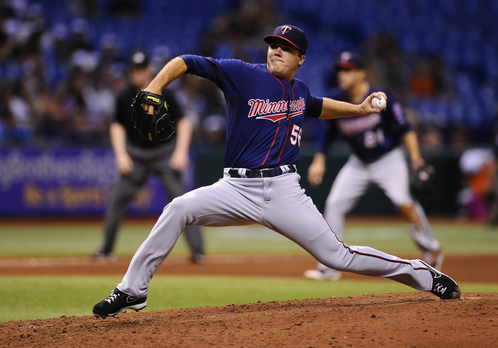 . Minnesota Twins relief pitcher Caleb Thielbar delivers to the Tampa Bay Rays during the seventh inning.(AP Photo/Brian Blanco)