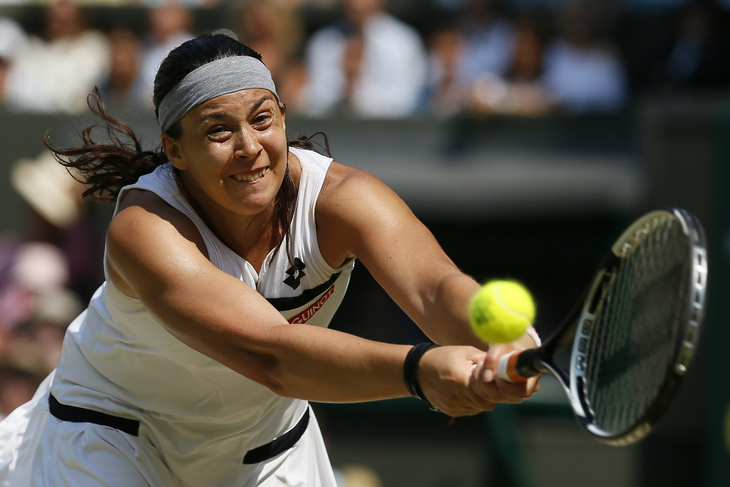 . France\'s Marion Bartoli returns against Germany\'s Sabine Lisicki in their women\'s singles final match on day twelve of the 2013 Wimbledon Championships tennis tournament at the All England Club in Wimbledon, southwest London, on July 6, 2013.  STEFAN WERMUTH/AFP/Getty Images