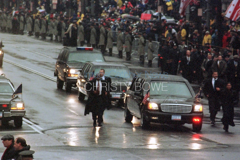 Protesters and supporters line the streets of Penn. Ave. as the presidential motorcade come by during the Inaugural Parade celebrating the 43rd president, George W. Bush.