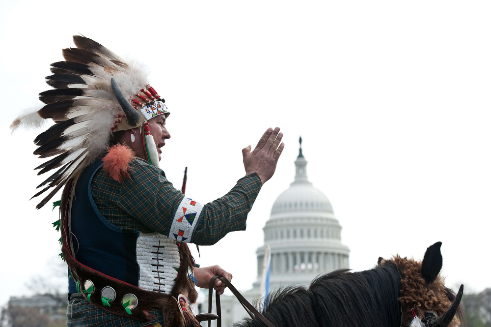 ". A Native American tribal leader sits on his horse in front of the US Capitol in Washington on April 22, 2014 as the Cowboy and Indian Alliance protest the proposed Keystone XL pipeline, part of ""Reject and Protect,\"" a weeklong series of actions by farmers, ranchers and tribes against the tar sands oil pipeline from Canada to the US.   (NICHOLAS KAMM/AFP/Getty Images)"