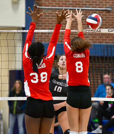 11/1/2018 Mike Orazzi | Staff Farmington High Schools Holly Picchioni (10) and Conards Fely Yigle-Kaljob (38) and Cate Di Giacomo (8) during the CCC Volleyball Tournament held at Avon High School Thursday night.