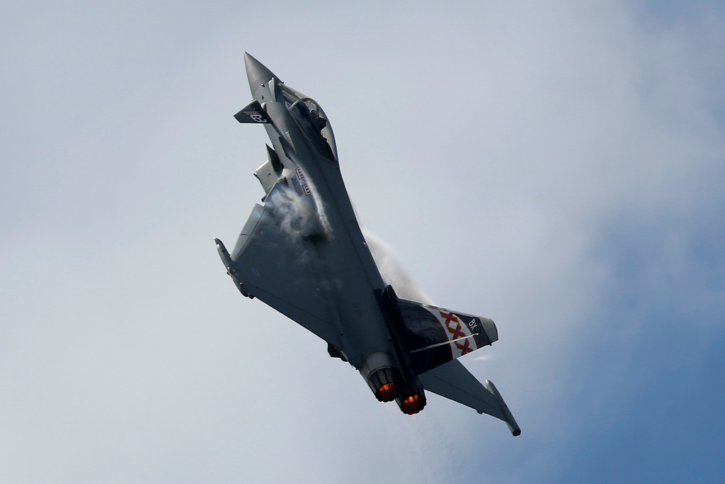 . A Eurofighter Typhoon flies on display during Farnborough International Air Show, Farnborough, England, Monday, July 14, 2014. (AP Photo/Sang Tan)