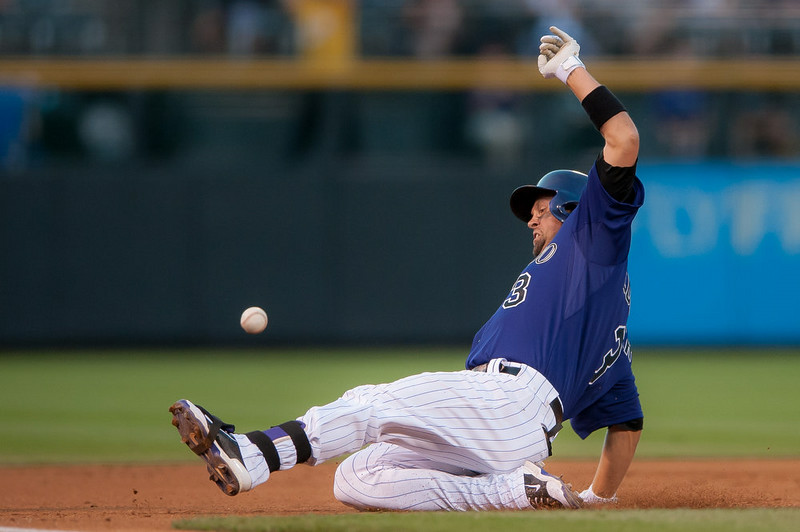 . Michael Cuddyer #3 of the Colorado Rockies beats the throw to third base with a first inning triple against the Cincinnati Reds during the second game of a split double header at Coors Field on August 17, 2014 in Denver, Colorado.  (Photo by Dustin Bradford/Getty Images)