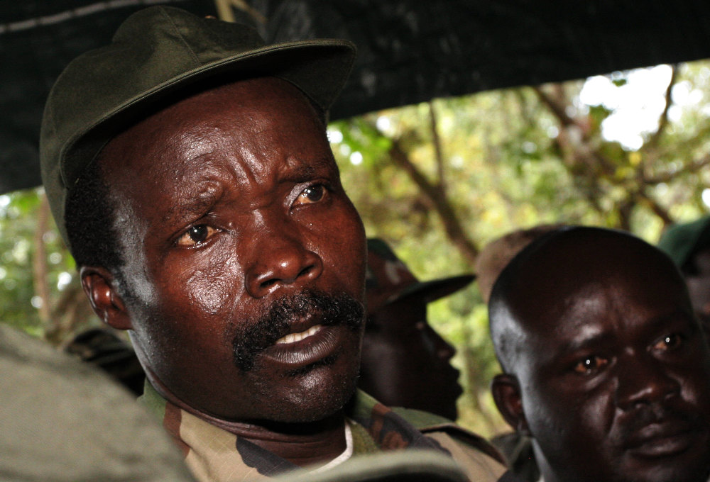 Description of . A picture taken on November 12, 2006 of then leader of the Lord's Resistance Army (LRA) Joseph Kony answering journalists' questions at Ri-Kwamba, in Southern Sudan. A former child soldier at the heart of a viral campaign to bring accused Ugandan war criminal Joseph Kony to justice said on March 9, 2012 he backed the video and urged people to watch it.