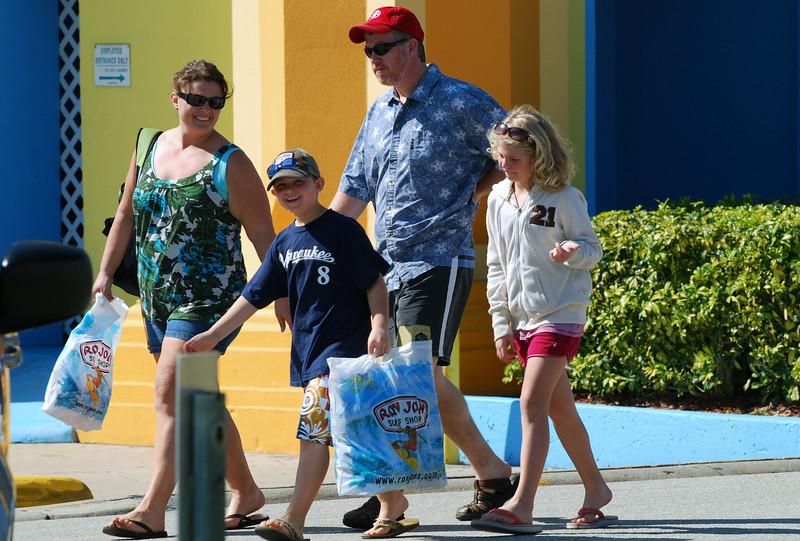 026 Cocoa Beach Tourists leaving Ron Jon Surf Shop.jpg