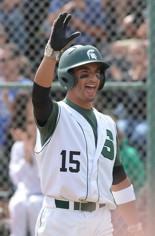 . South\'s Mike Esparza (15) celebrates as after crossing home against Estancia in a first-round CIF SS Division IV baseball game Friday in Torrance. South won 7-2. 20130517 Photo by Steve McCrank / Staff Photographer