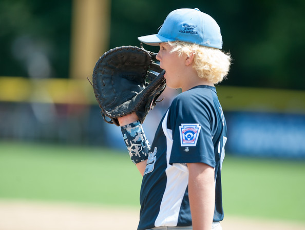 08/06/18 Wesley Bunnell | Staff Rhode Island defeated Vermont 10-0 in a 2018 East Regional Little League game in Bristol on Monday afternoon. Vermont's Nick Kelly (14) chews on his first base mitt between plays.