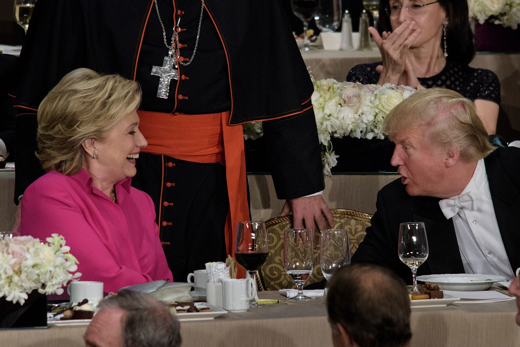 . TOPSHOT - Democratic presidential nominee Hillary Clinton (L) and Republican presidential nominee Donald Trump shake hands after speaking during the Alfred E. Smith Memorial Foundation Dinner at Waldorf Astoria October 20, 2016 in New York, New York. (BRENDAN SMIALOWSKI/AFP/Getty Images)