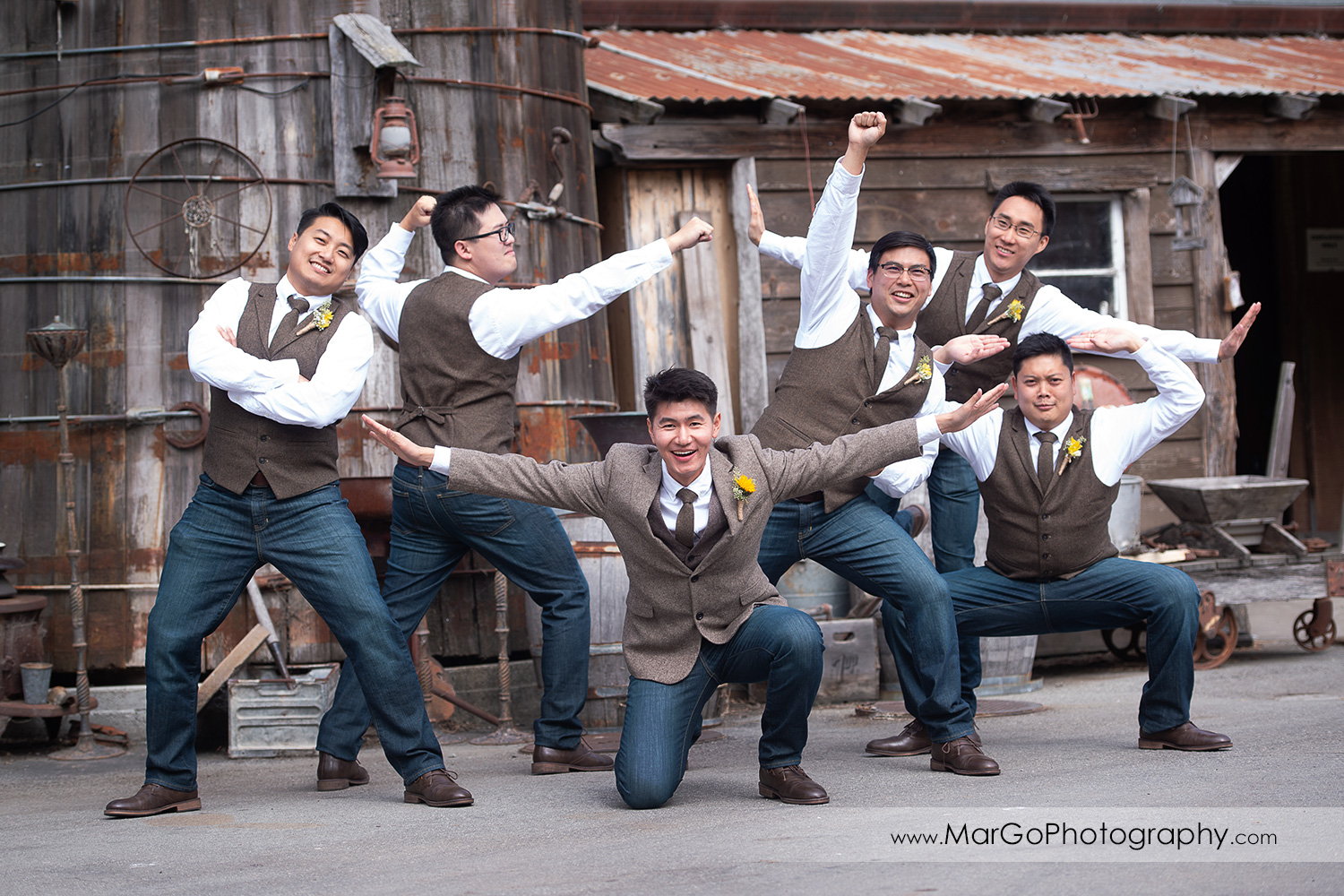 groom and groomsmen in manga superheroes poses at Long Branch Saloon & Farms in Half Moon Bay