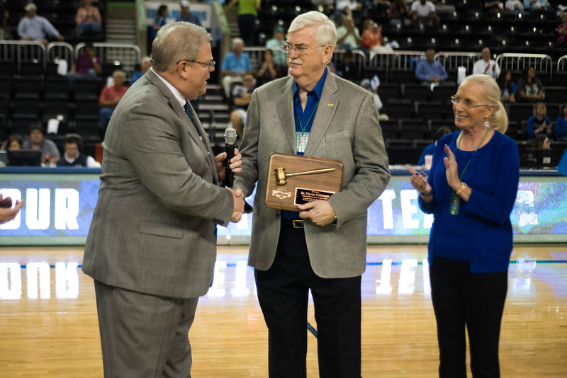 Tom Burnett (left), Commissioner of the Southland Conference, thanks TAMU-CC President Flavius Killebrew for his outstanding service to the Southland Conference during halftime at American Bank Center on November 29, 2016.